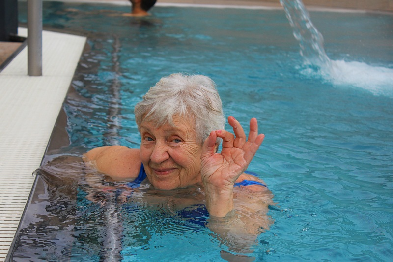 Senior woman swimming in a pool
