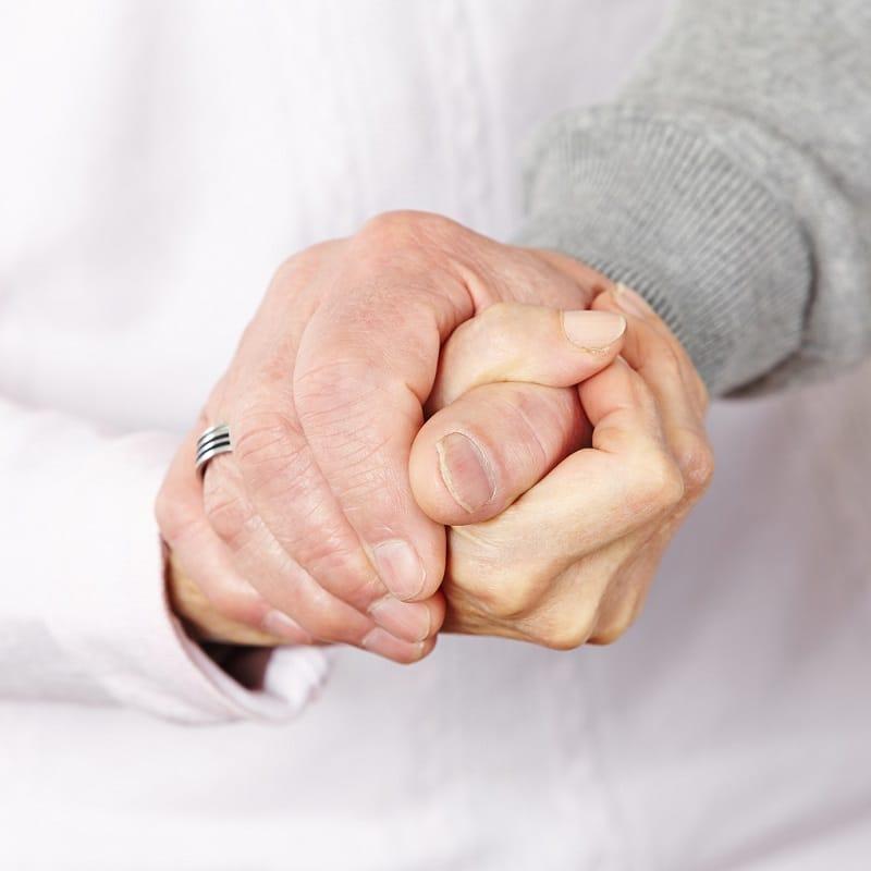 Happy senior couple holding hands
