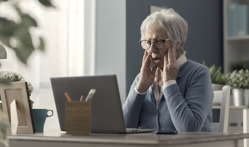Senior woman struggling with technology