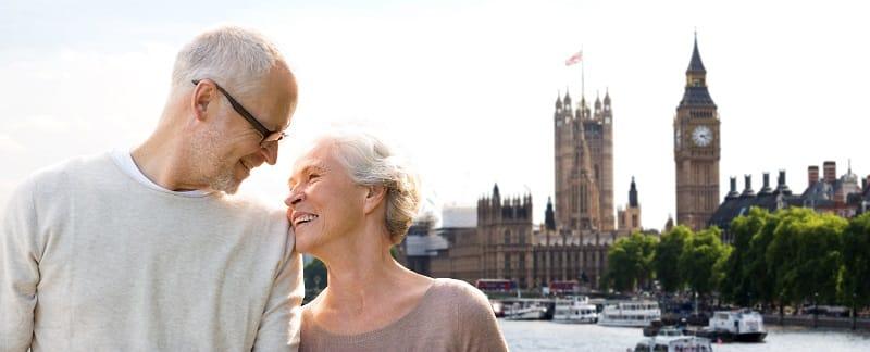 happy senior couple in london city